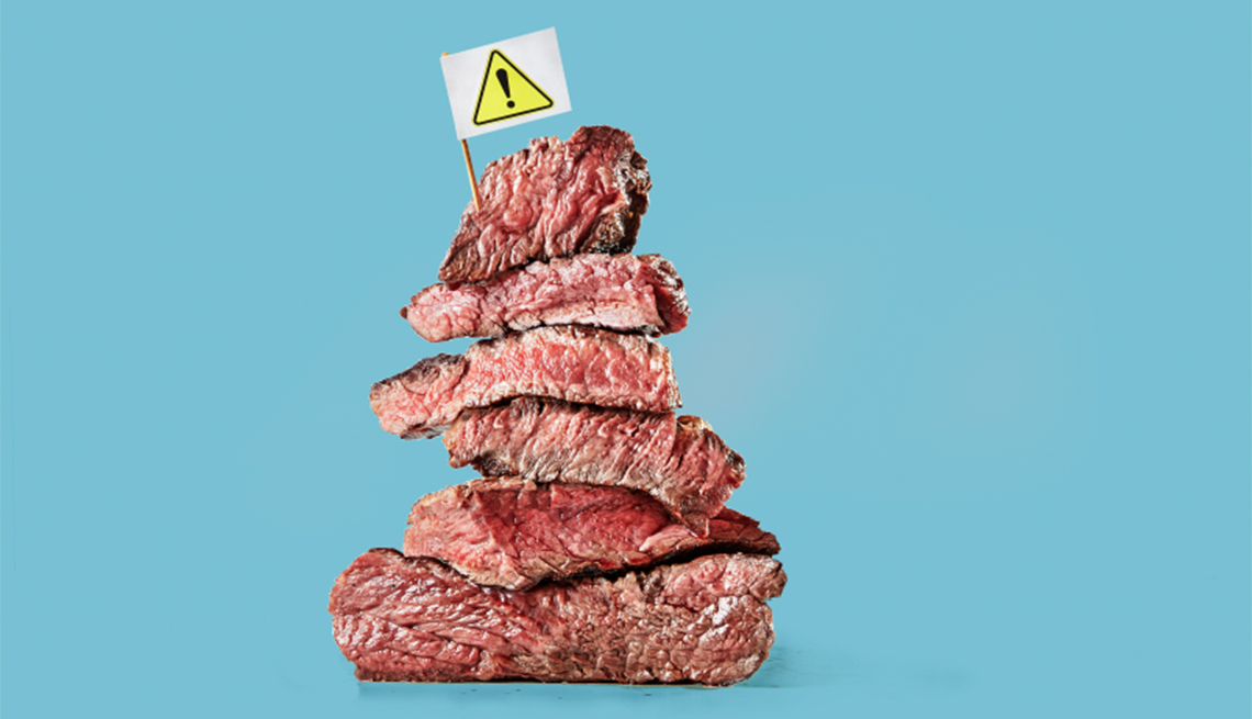 stack of meat with caution sign on top