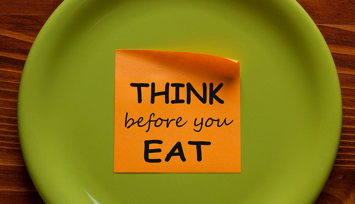 Think Before You Eat written on sticky note on a green plate.