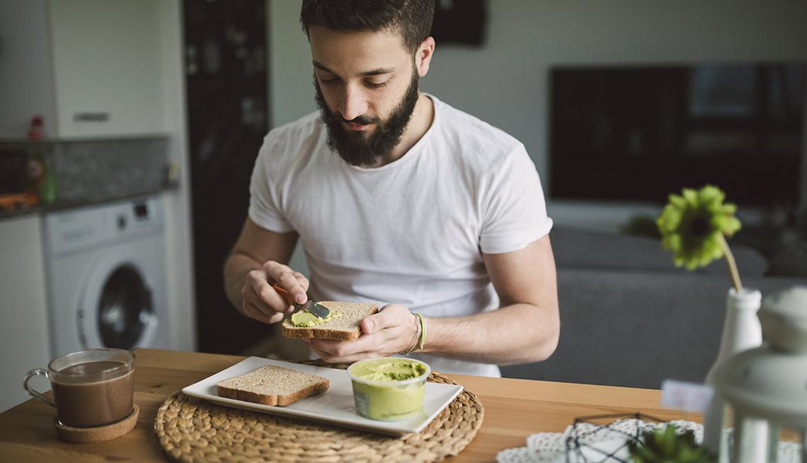 young person having avocado toast