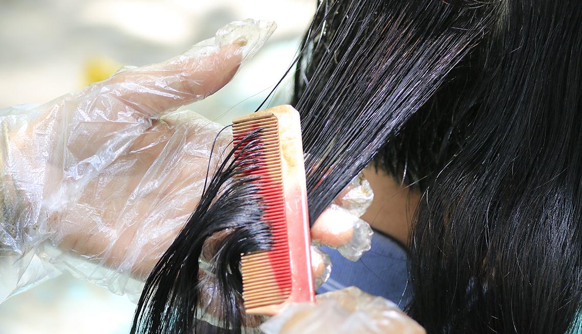 A person getting their hair colored