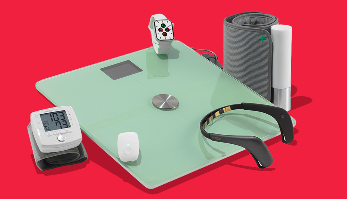 a grouping of fitness devices. clockwise from top are an apple watch, moca cuff blood pressure monitor, muse 2 headband, withings body plus scale, upright go posture trainer, and withings blood pressure  monitor