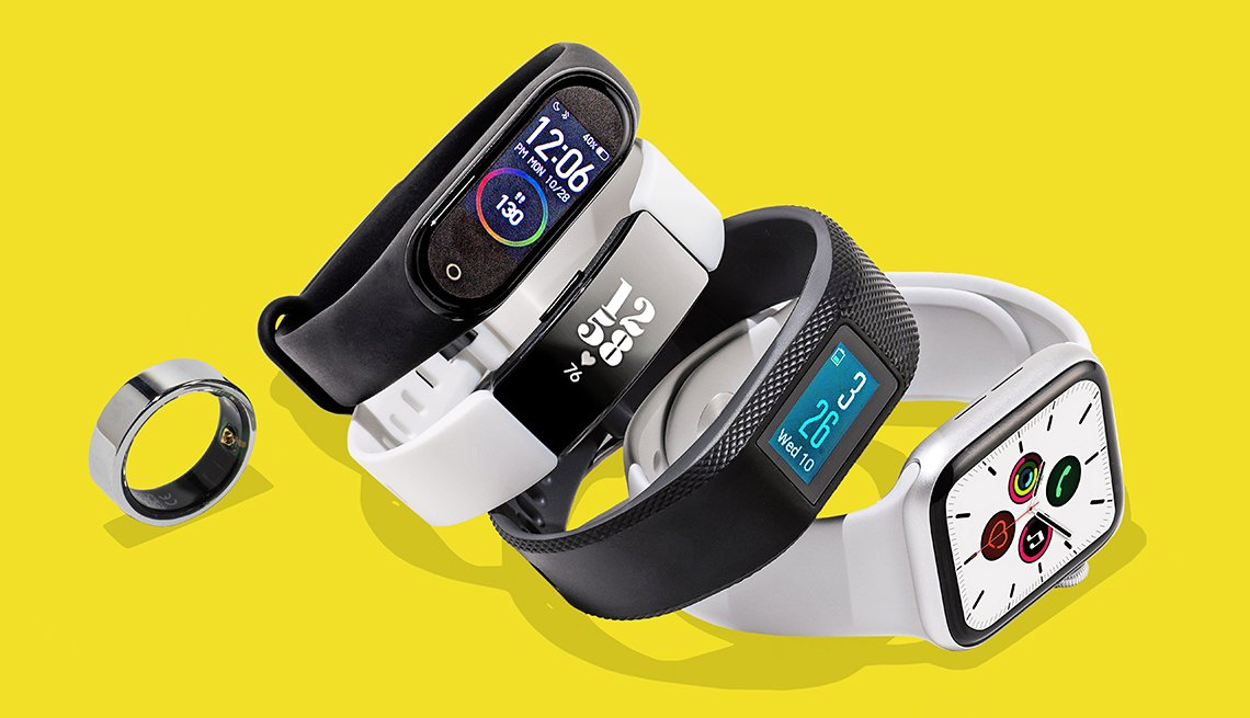 five types of fitness trackers are pictured. from left to right are the oura ring, mi smart band 4, fitbit inspire hr, garmin vivosport, and apple watch