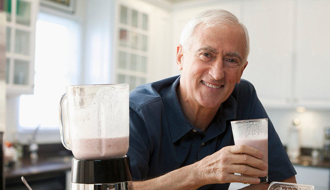 man drinking smoothie that he has just made in a blender