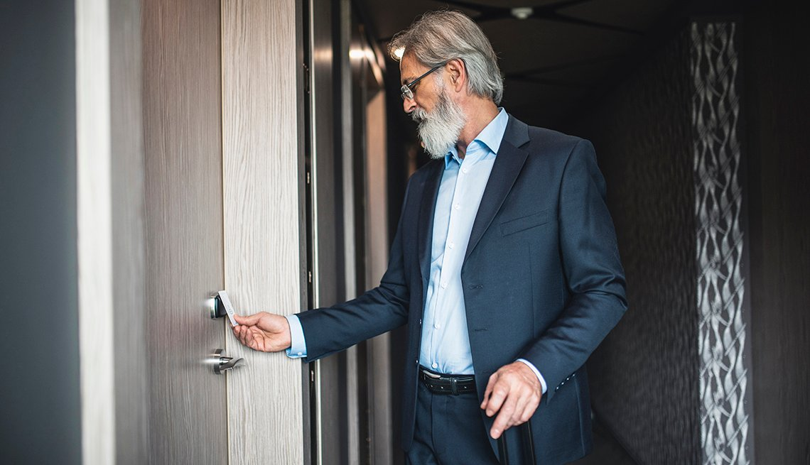 A man uses a keyless entry card to enter his hotel room