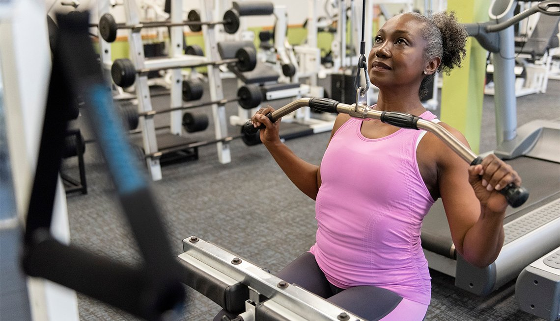 Older African American woman doing weight training