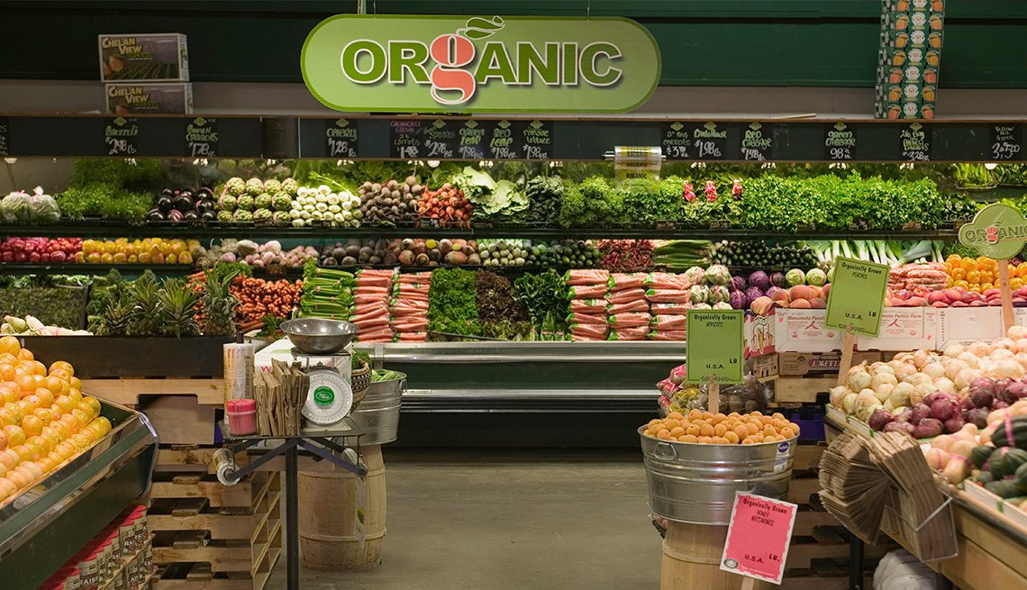 organic sign in produce section of grocery store