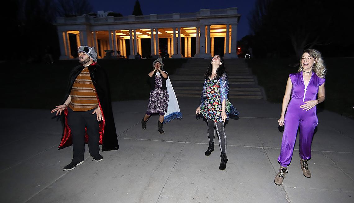 item 4 of Gallery image - Brice Maiurro, Shelsea Ochoa, Anna Beazer and Kali Healf, from left, howl in Cheesman Park in Denver, during. the coronavirus outbreak.