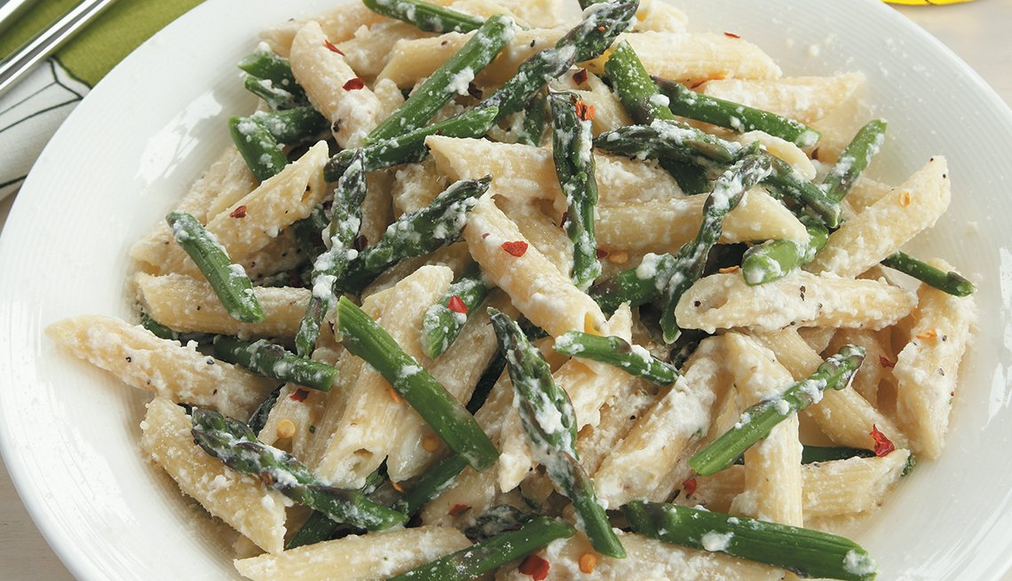 cooked dish of penne, ricotta and asparagus