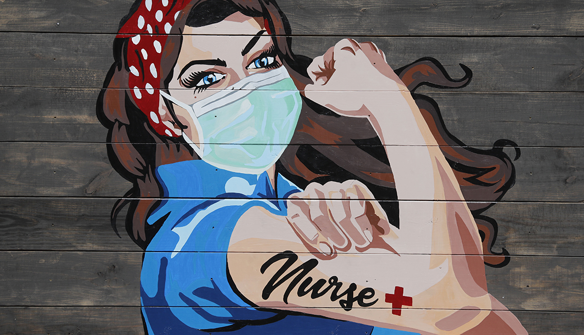 item 2 of Gallery image - A mural near a hospital pays tribute to nurses amid COVID-19 concerns in Dallas, Tuesday, April 7, 2020.