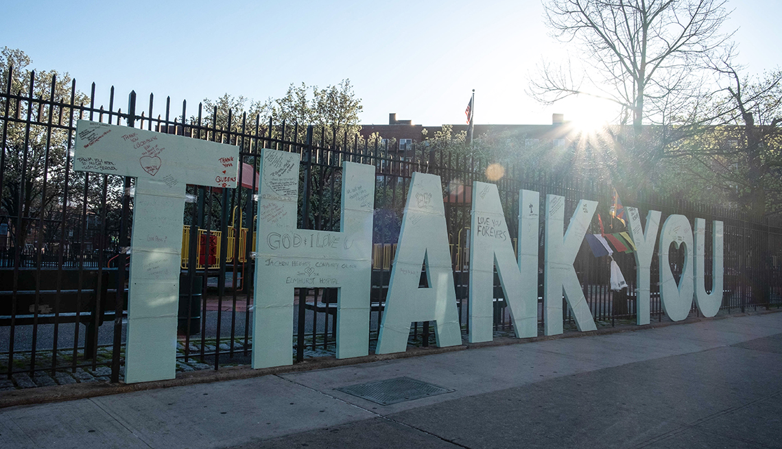 """item 1 of Gallery image - A large sign saying """"Thank you"""" was placed in front of the Elmhurst Hospital in Queens to thank medical workers amid the coronavirus outbreak."""