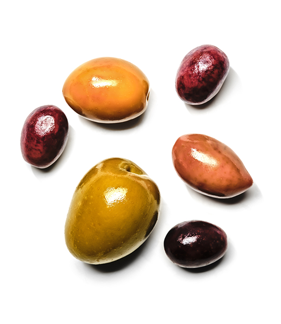 several different kinds of olives are shown on a white backgrounf