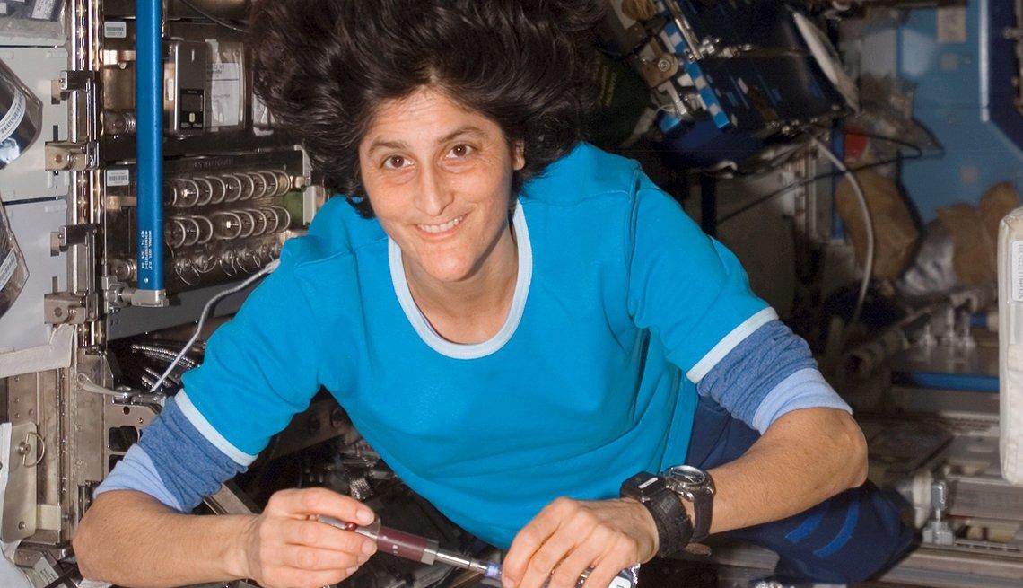 inside a spacecraft in zero gravity an astronaut works on instruments