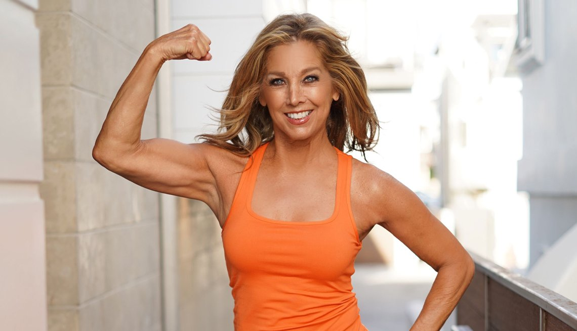 denise austin poses with a bicep curl