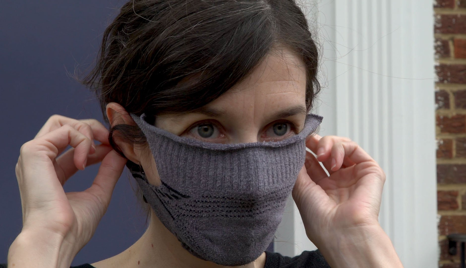 woman trying on homemade sock face mask