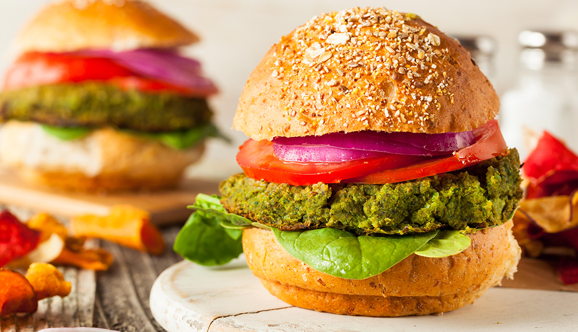 green vegan burgers with lettuce and tomato