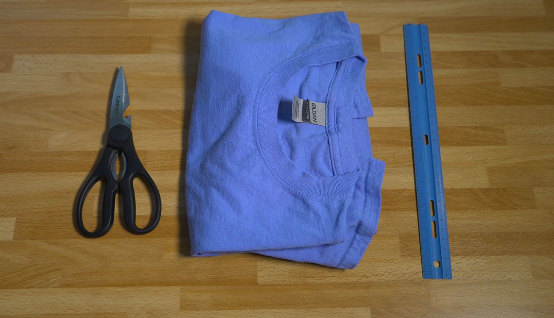 Scissors, t-shirt and ruler on a table