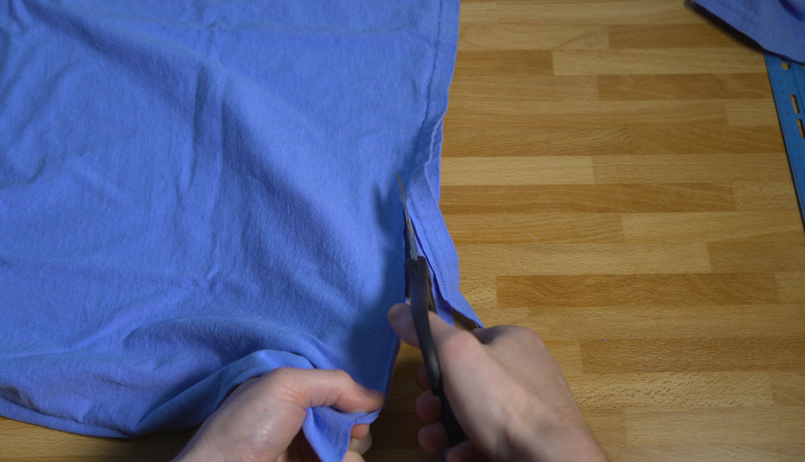 Cutting a strip from the bottom of a cotton t-shirt