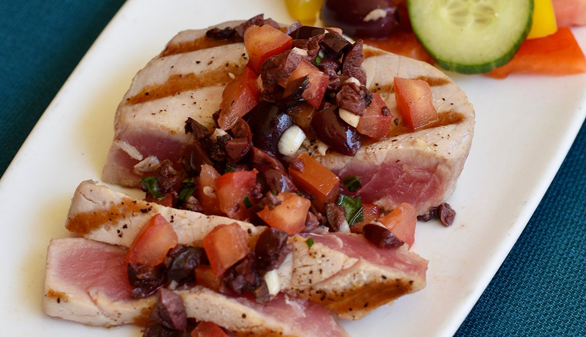 plate of grilled ahi tuna topped with tapenade