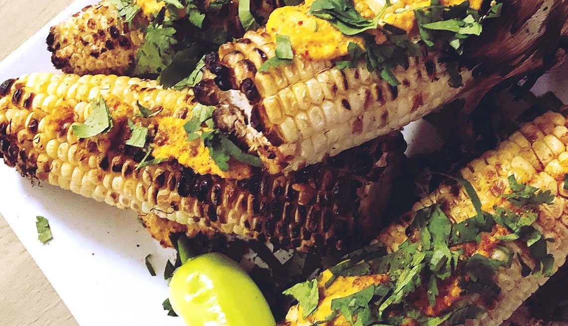 plate full of grilled corn with seasoning