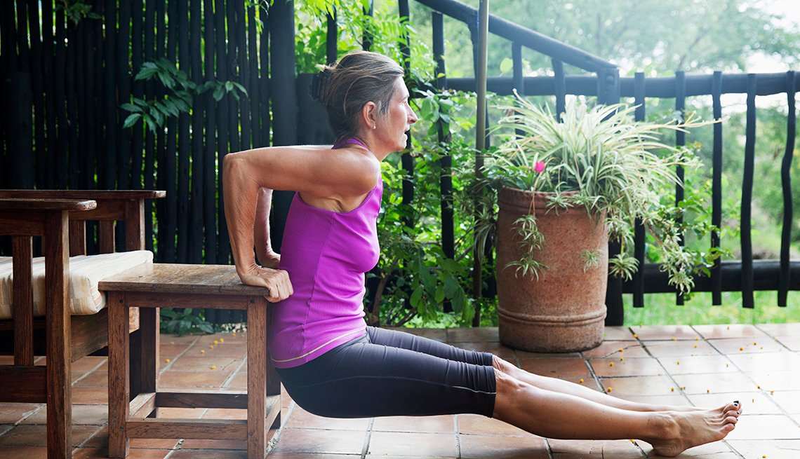 woman exercising outdoor on her patio