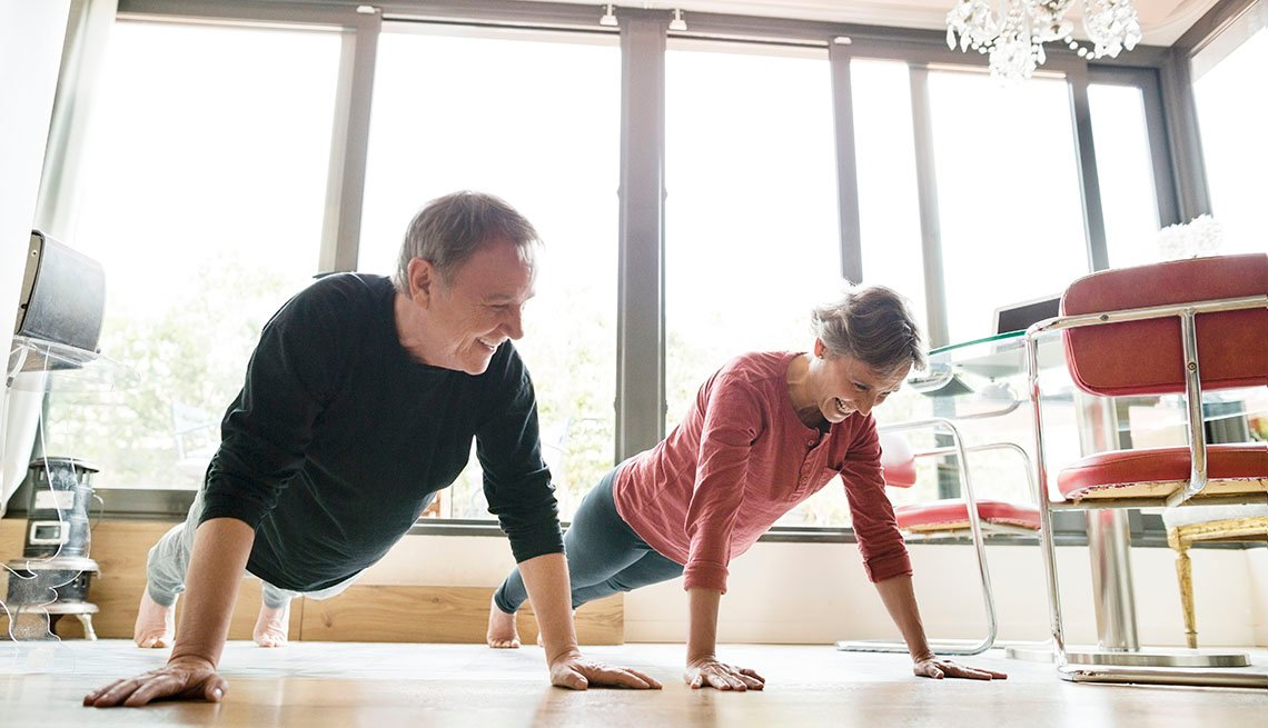 couple exercising in their dining room