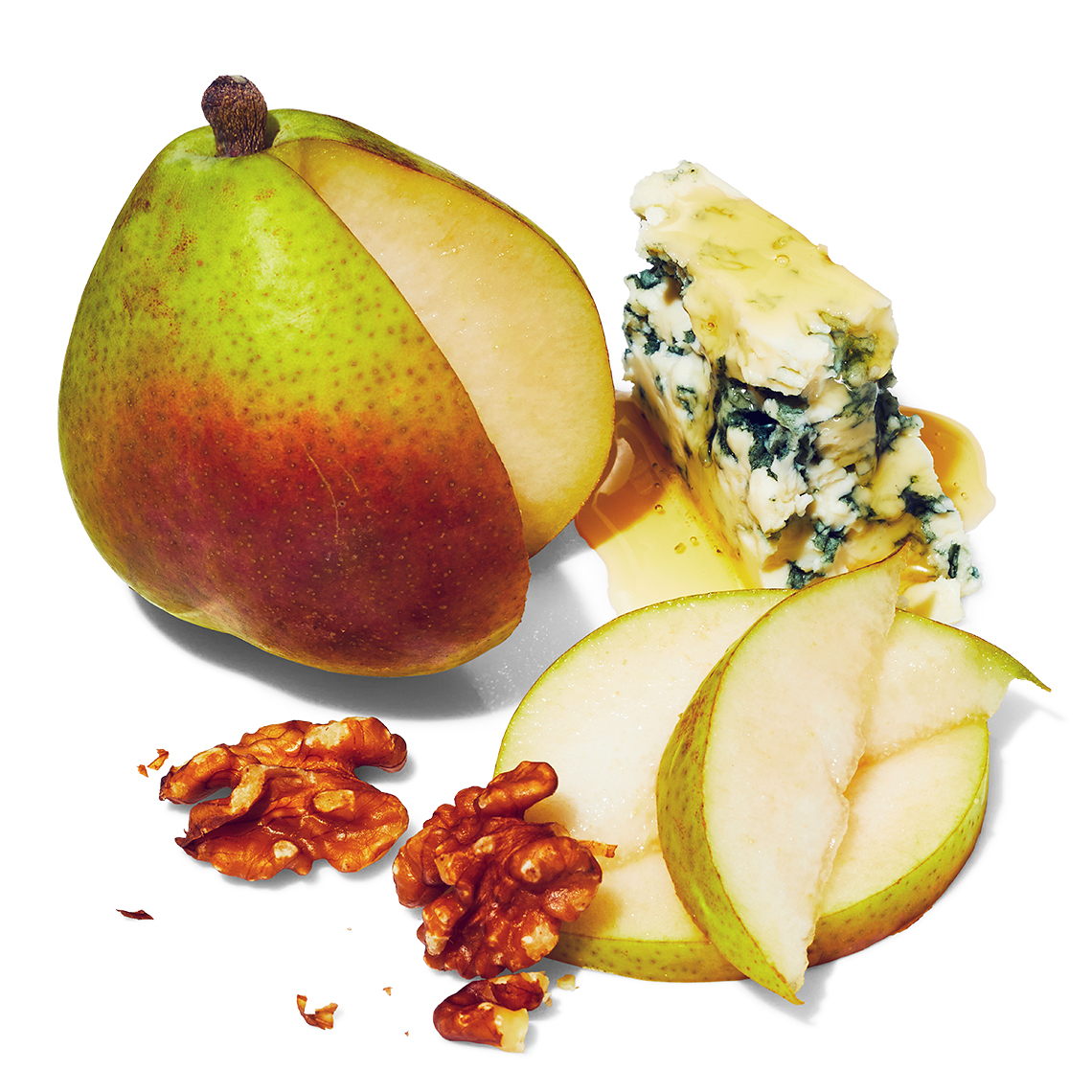 fresh pear sliced with walnuts and blue veined cheese