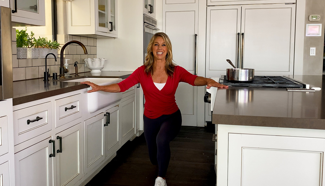 Denise Austin working out in her kitchen