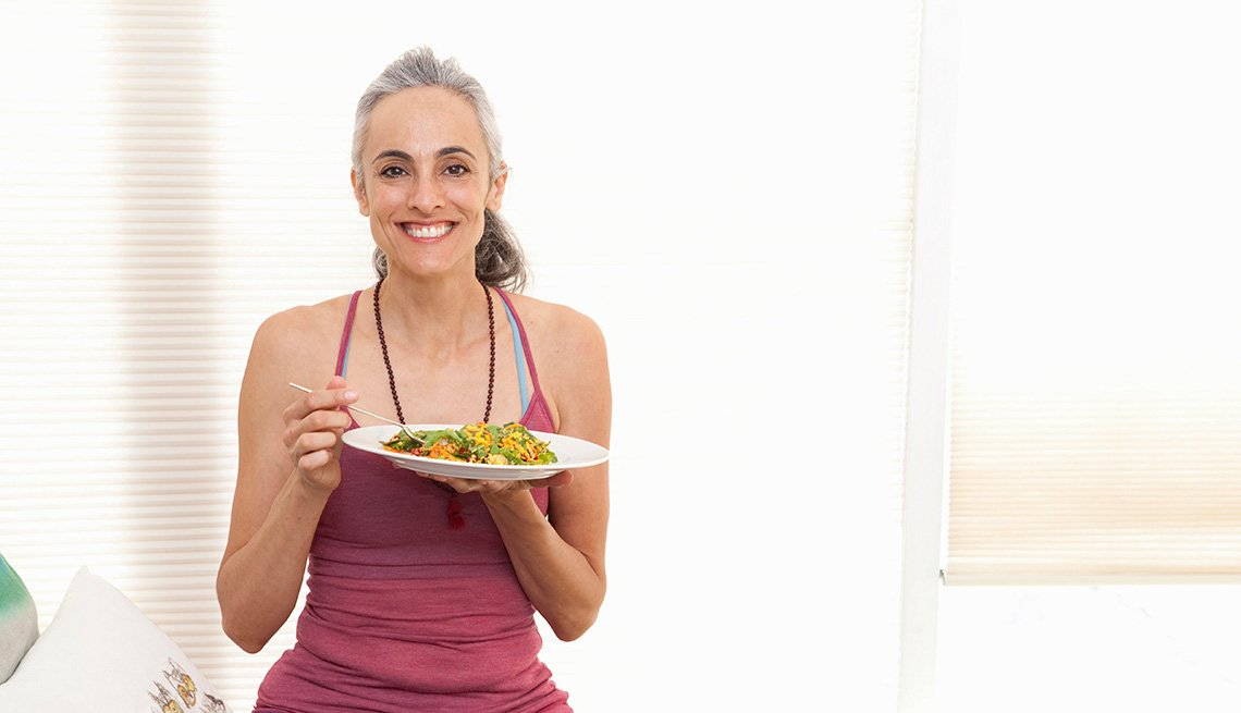 woman holding plate of food