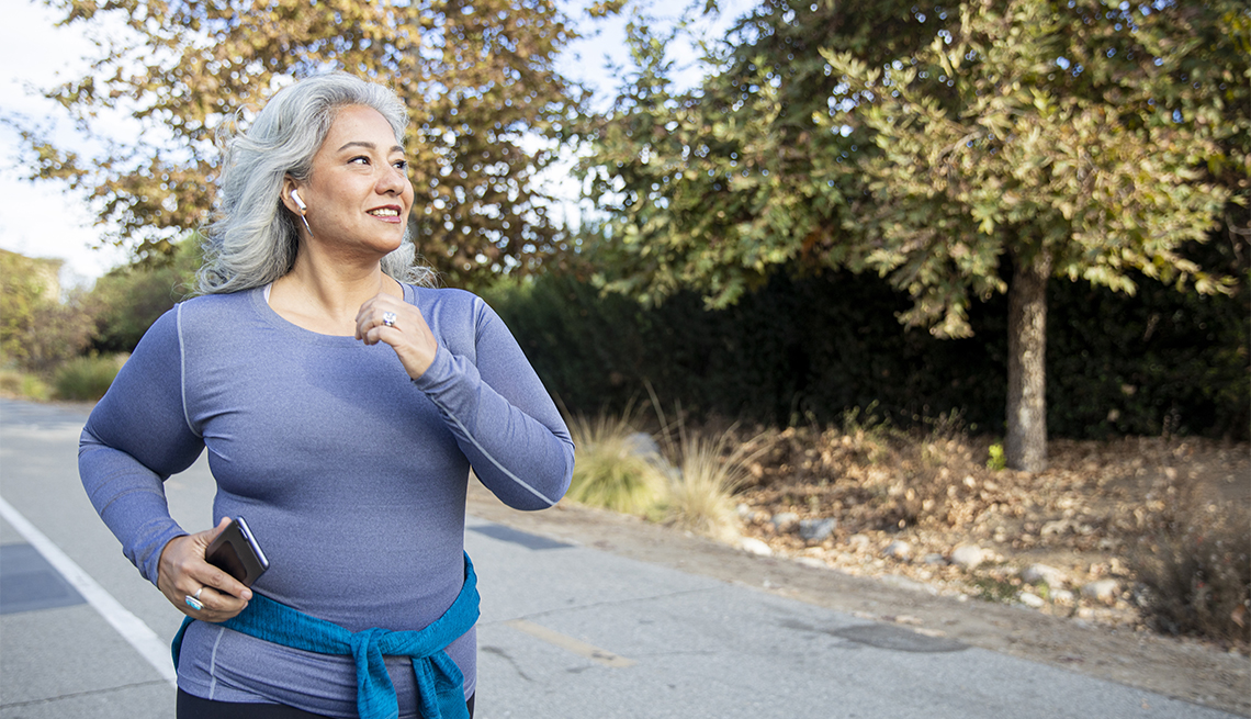 A woman jogging on a trail
