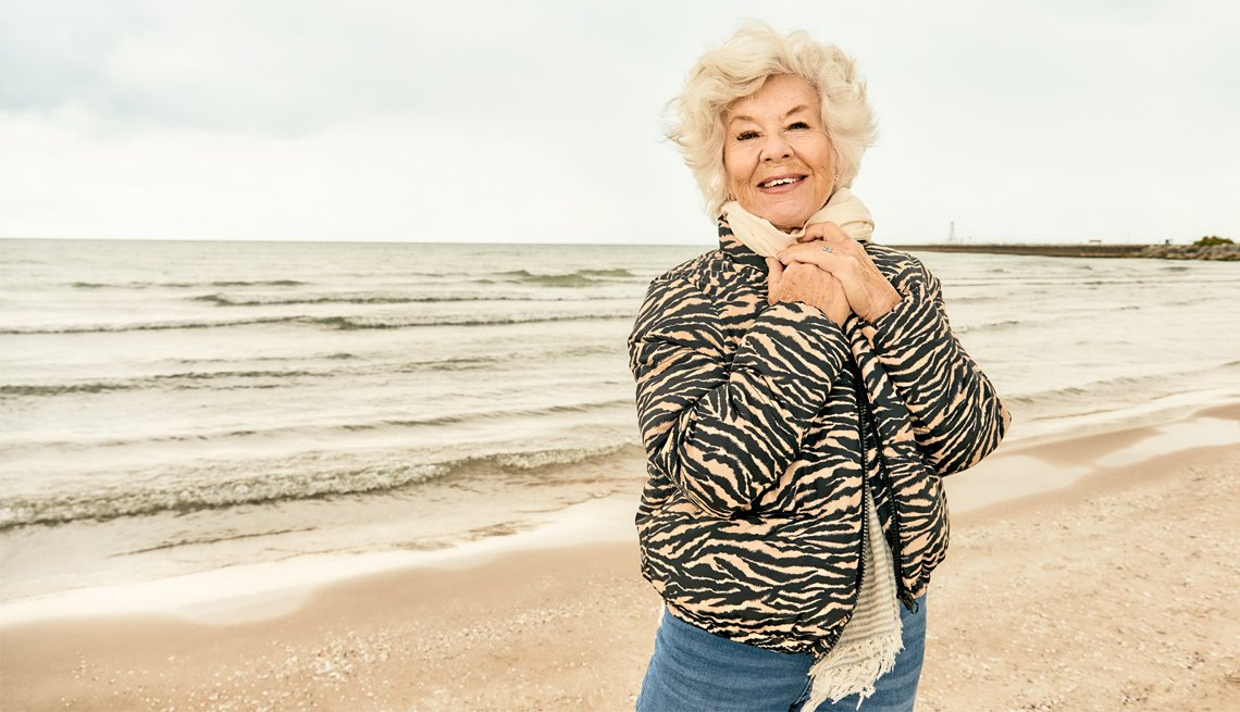 joan macdonald standing on the beach