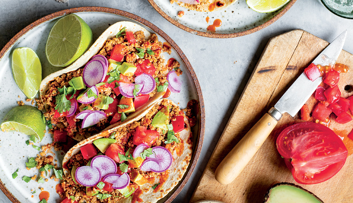 cauliflower tacos on a plate with radishes and lime