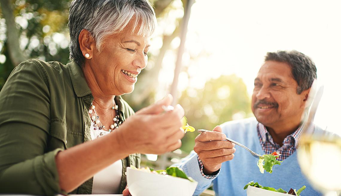 a couple eating salads
