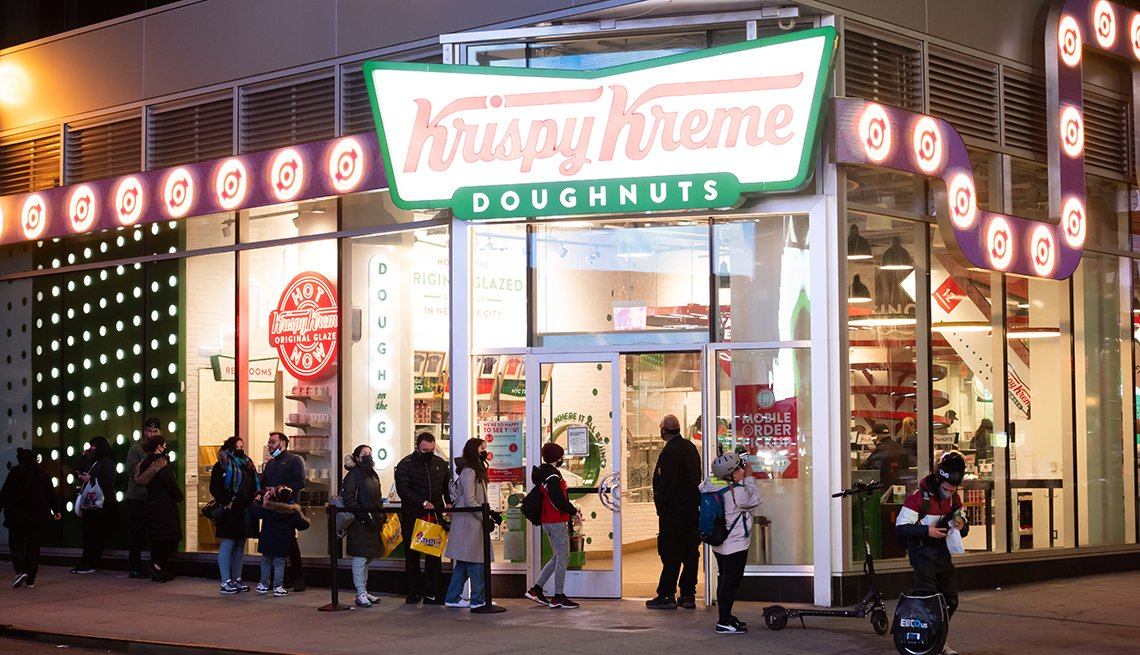 people line up outside Krispy Kreme in Times Square in New York City