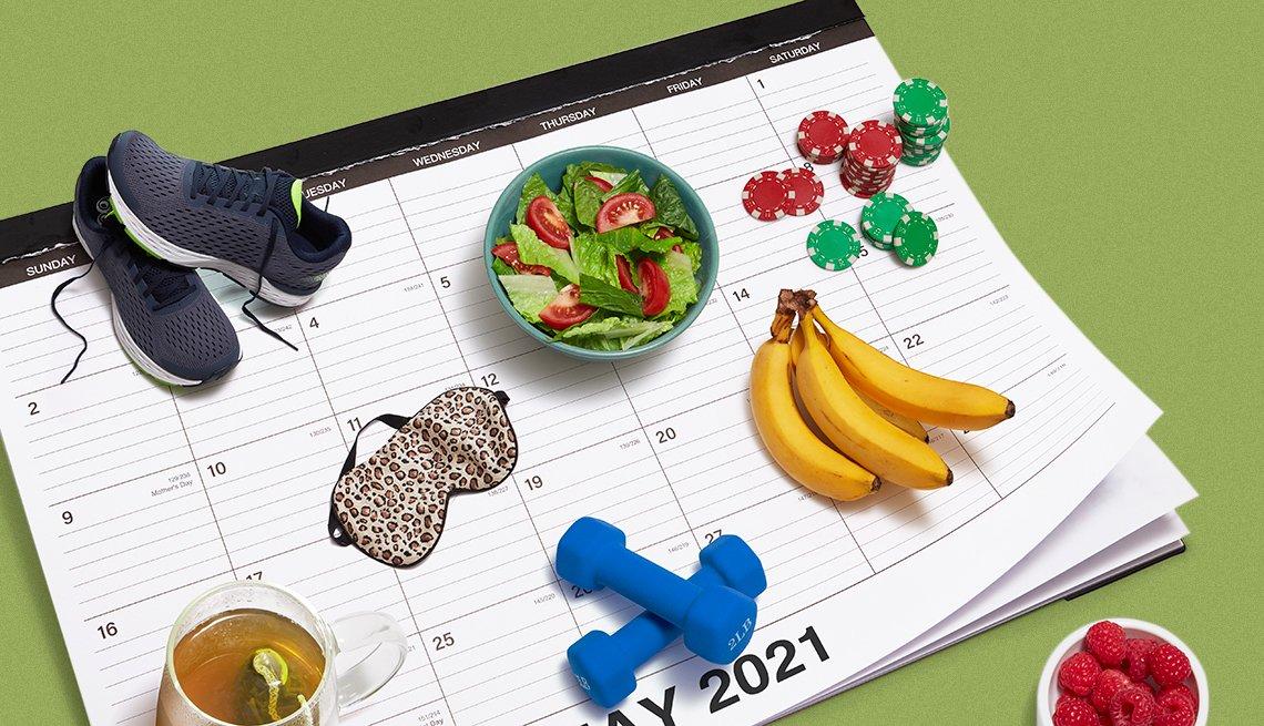 Calendario de escritorio con objetos relacionados a la salud, unas zapatillas de correr, una taza de te, un plato hondo con ensalada, frutas y unas mancuernas