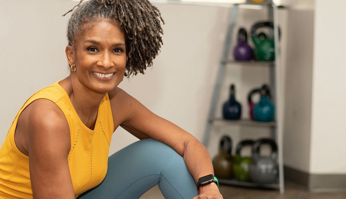 Fitness influencer Carla Kemp sitting in gym and smiling