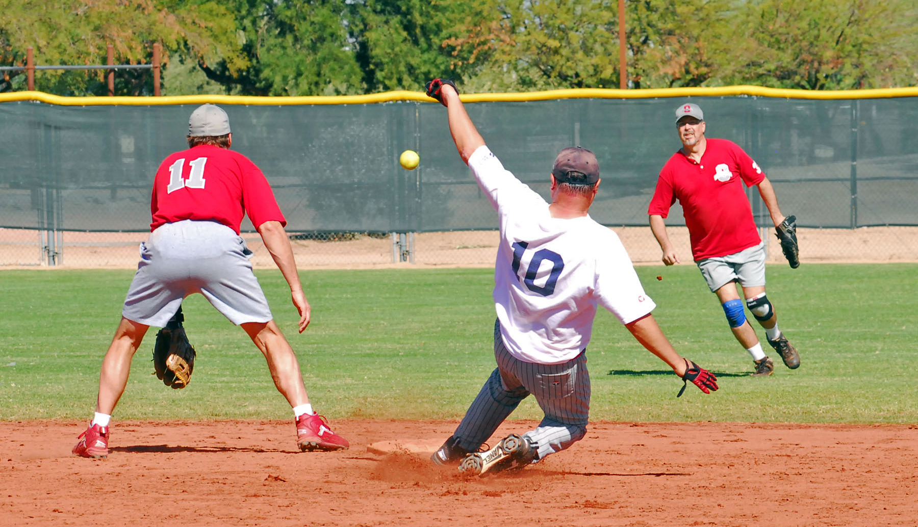 terry hennessy sliding into second base at a baseball championship game in phoenix arizona