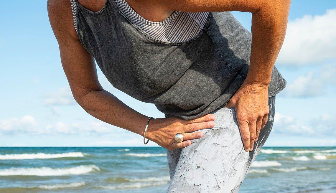 woman holding hip
