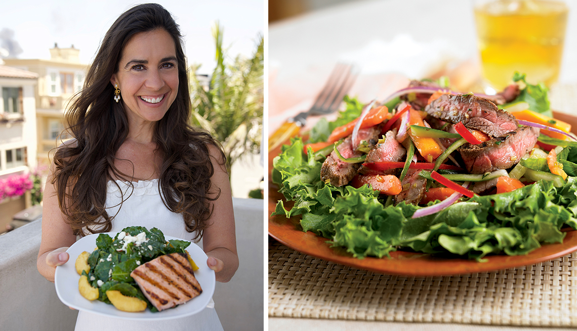 chef devin alexander showing us a kale peach salad dish with salmon and a thai beef salad