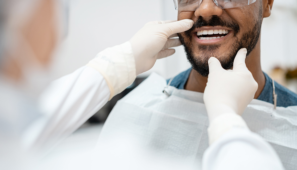 man having teeth looked at after a teeth whitening procedure