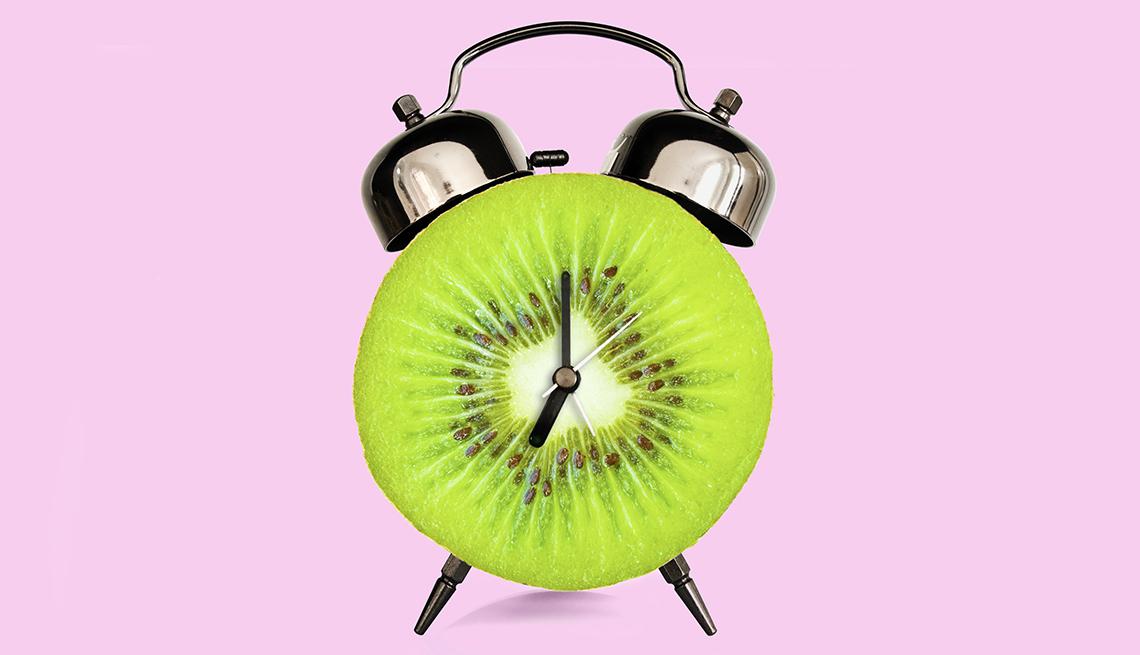 Rebanada de Kiwi forma un reloj despertador