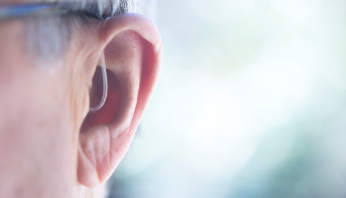Closeup of Hearing Aid in Man's Ear