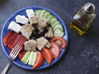 Meze salad plate with olive oil.
