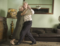 Senior Hispanic couple dancing