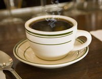 Cup of coffee on diner countertop (focus on coffee cup)