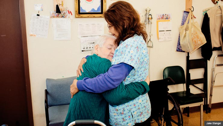Esther Darling hugs physical therapist Yolanda Azevedo.