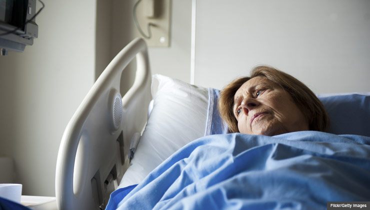 Patient In Hospital Bed Looking Pensively At The Window, The Cost Of Being  Labeled Observed