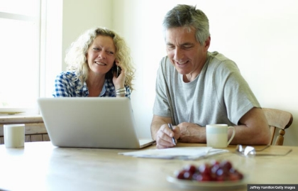 Research different options and costs for Medicare open enrollment. (Richard Drury/Getty Images)