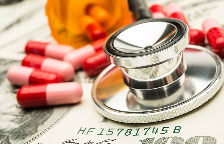 Stethoscope and pills on top of a pile of 100 dollar bills, Different Ways to Pay Medicare Premiums