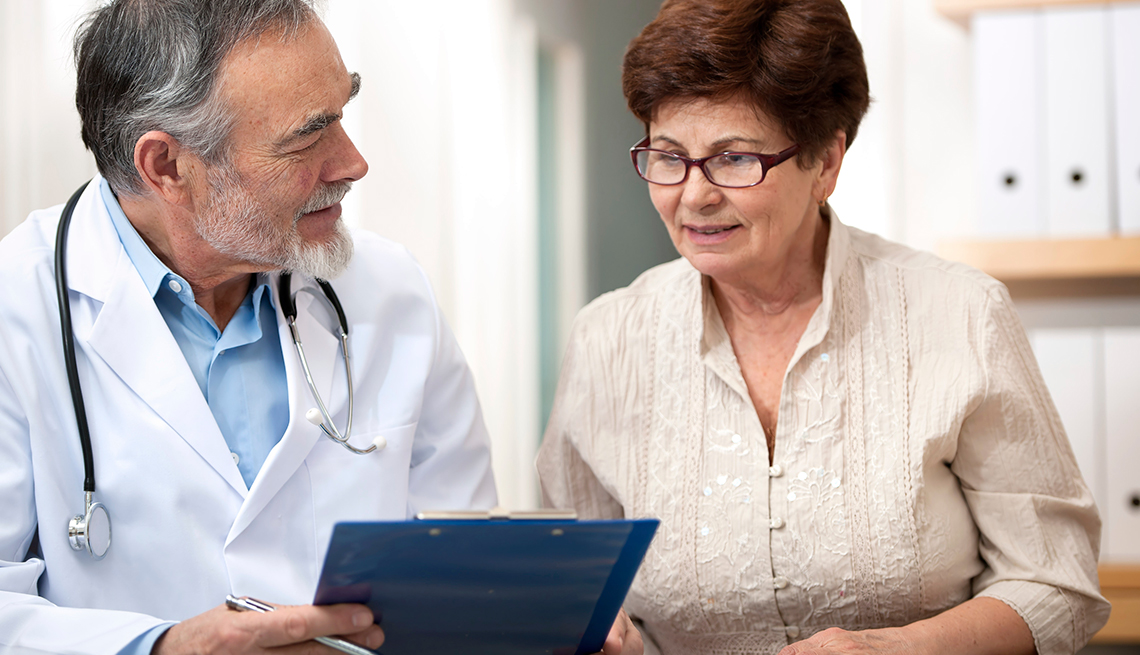 A doctor helps a new patient understand Medicare, how to enroll, and her payment options.