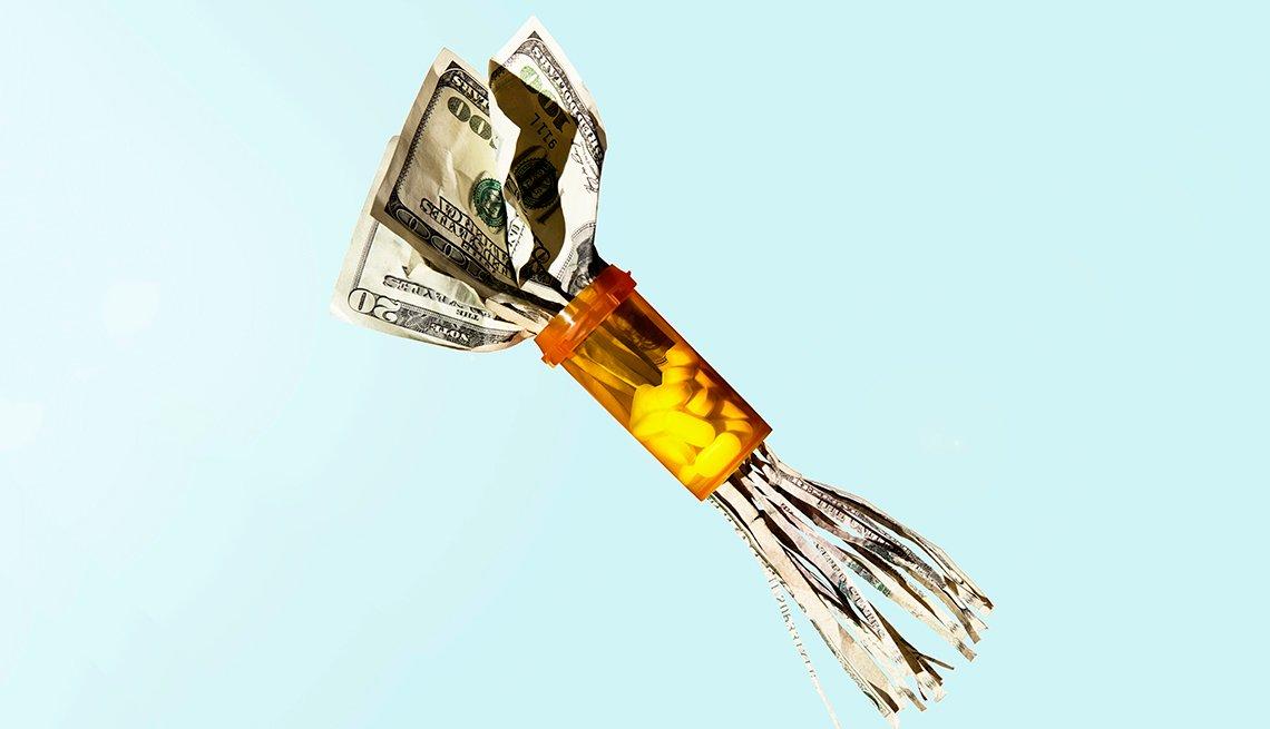 Dollar bills made into shreds by bottle of prescription drugs
